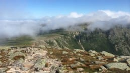Clouds settle over the top of Baxter Peak on Mount Katahdin.