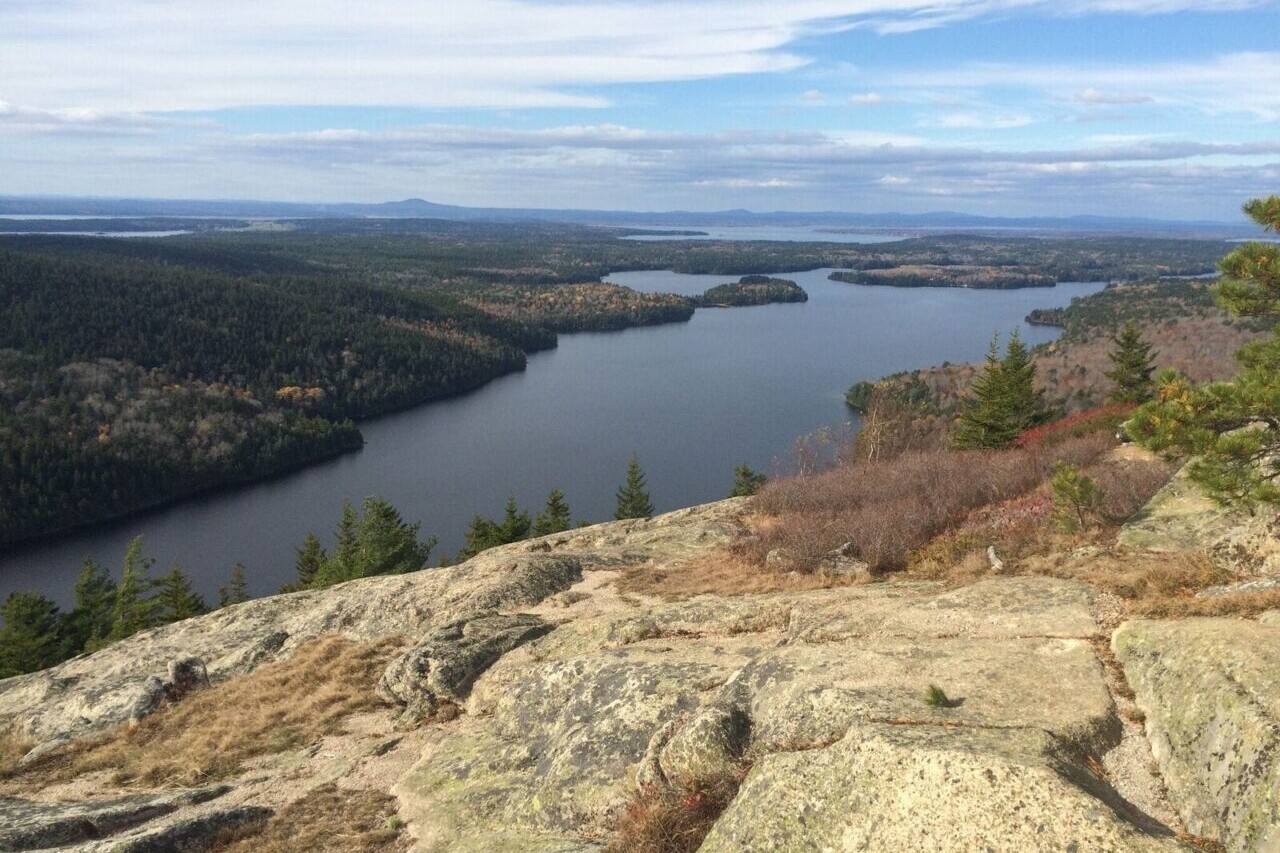A rocky ridge overlooks a lake.