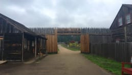 a wooden gate at Fort Vancouver is open to a garden beyond.