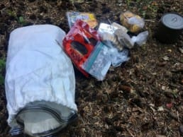 Hiking food piled on the ground in the wilderness