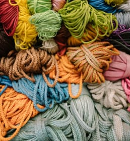 many varieties and colors of cord and utility line are all in a pile.
