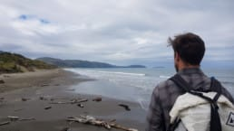 A man on a beach in New Zealand.