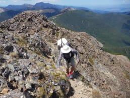 A hiker on a rocky mountain on the Te Araroa.