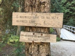 A trail sign for Maxwell Lake.
