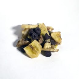 A pile of GORP trail mix including chocolate and fruit.
