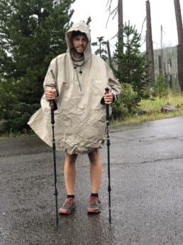 A thru-hiker in a rain poncho.