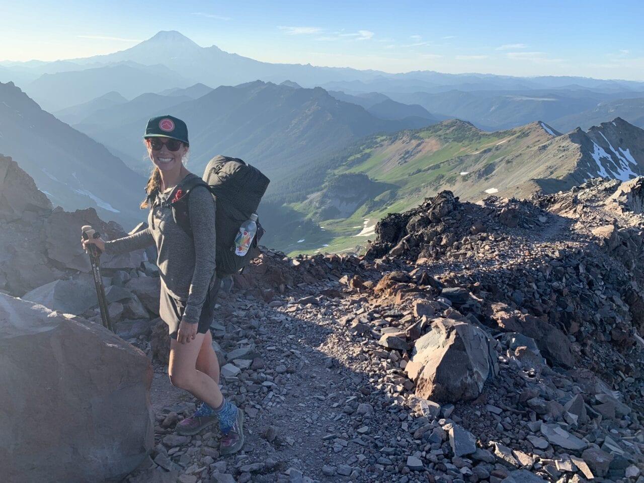 A woman hiking on a mountain.