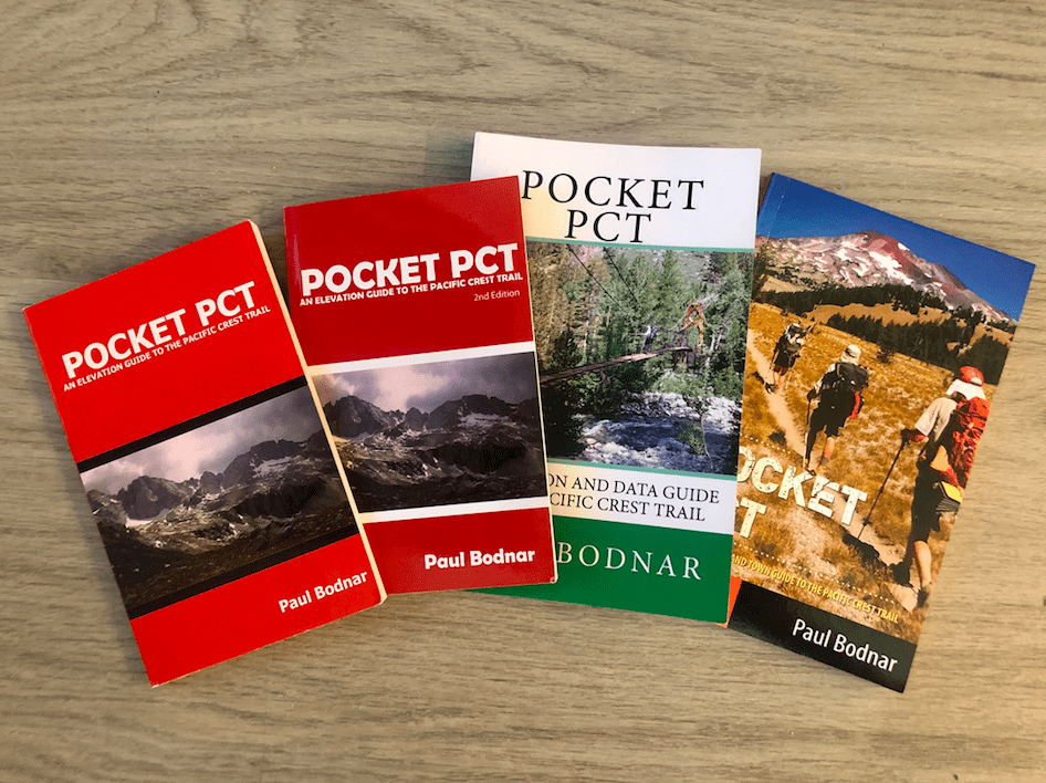 Four editions of the Pocket PCT guide book next to each other.