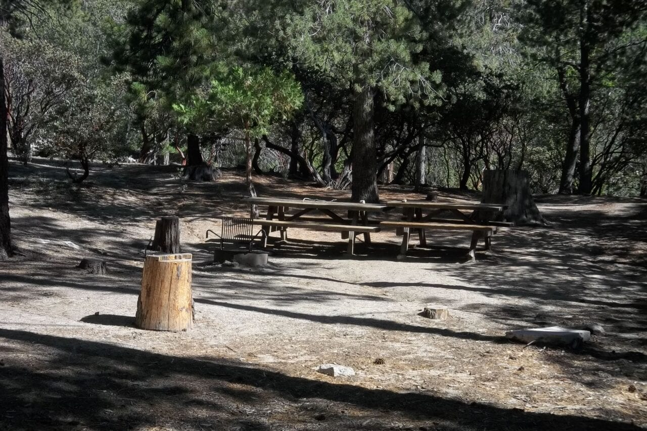 An empty campground with picnic tables on the Pacific Crest Trail.