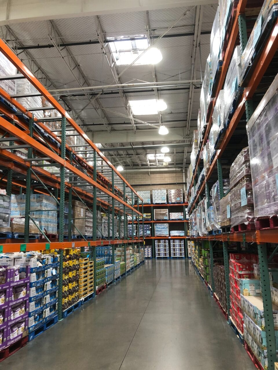 View of an aisle of products in a Costco store.