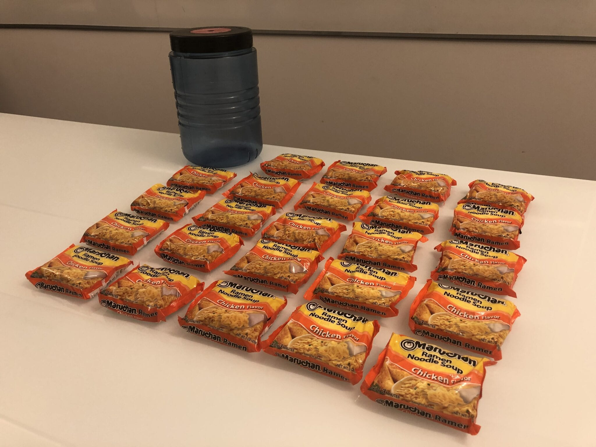 24 Ramen packages laid out next to a BV500 bear canister.